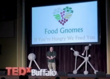 presenter Matthew Schwartz on the TedX Buffalo stage for his presentation.