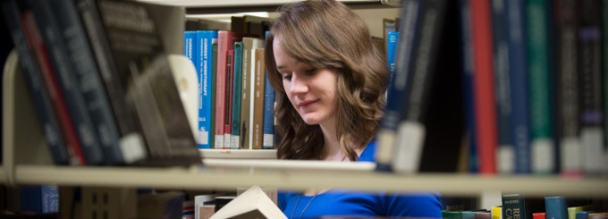photo of U.B. student, Lauren, in library.
