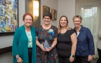 award winner Nancy Kusmaul pictured with three others.