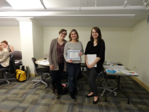 Picture of Samantha Koury and Rachel Wilson with a champion team member from the AIDS Institute Closing Training