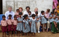 faculty with children in India