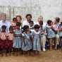 faculty with children in India.